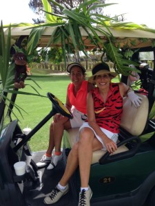 Linda (right) and her sister Debbie golfing for charity